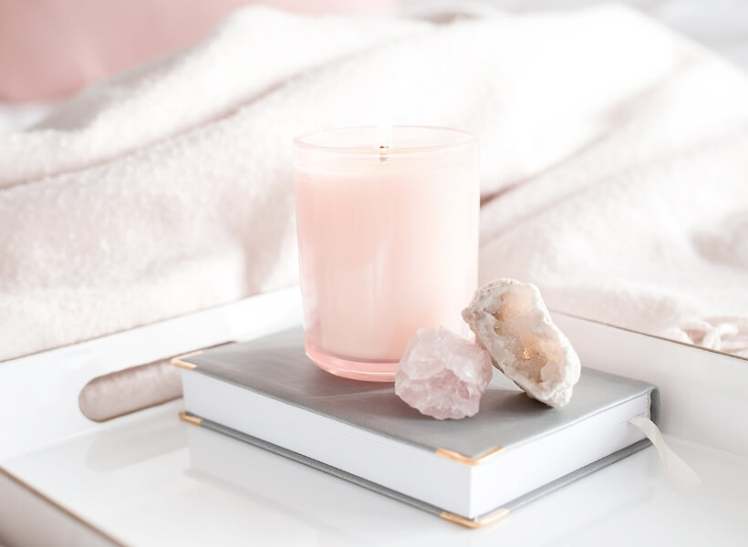 Candle and a journal on a tray