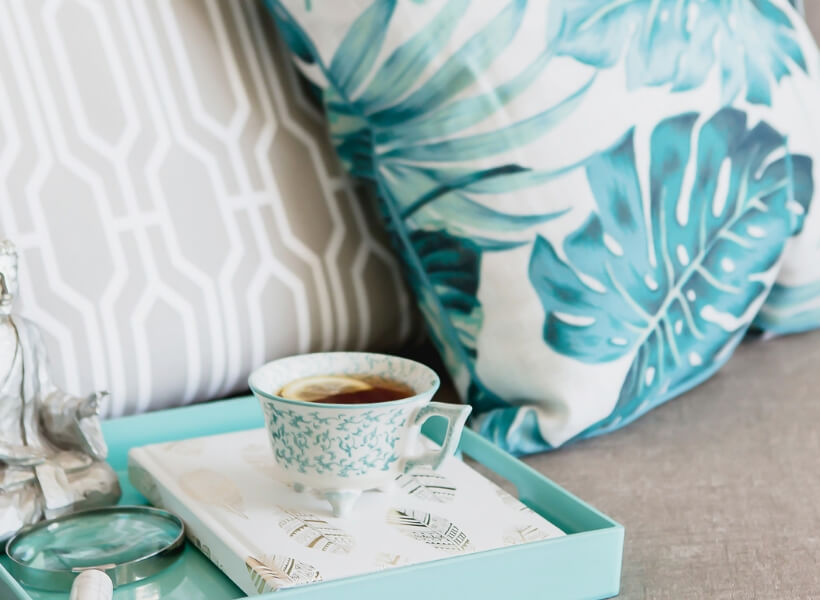 Pillows and tray with tea