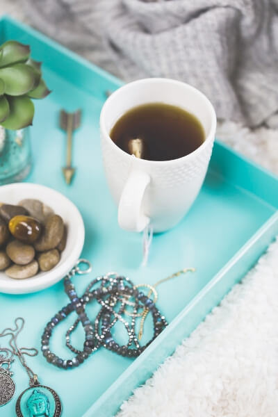 Tray with tea and stones